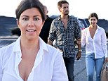 No sign of strife! Kourtney Kardashian and Scott Disick look blissfully happy as they stroll arm-in-arm despite reports of fight on reality show