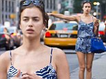 All hail Irina Shayk! Model flags down a taxi in New York as she puts on a long and leggy show in playsuit