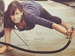 Run out of ideas? Makeup-free Hilaria Baldwin shows off cleavage while holding water hose in bizarre yoga pose