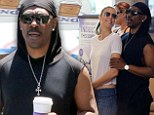 Eddie Murphy cosies up to model girlfriend Paige Butcher as they grab coffee before zooming off in his luxury Rolls-Royce convertible