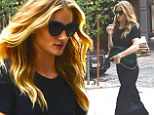 Rosie Huntington-Whiteley is effortlessly chic in simple black frock as she arrives at her New York hotel