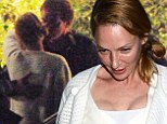The kiss: Quentin Tarantino and his 'muse' Uma Thurman share passionate embrace after dinner date