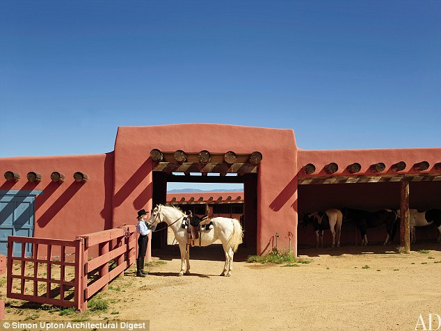 Posing with her Arabian mare Gitane: The 9,600-square-foot dwelling includes the Hacienda, a 2,125 square-foot guest home, a 3,400 square-foot log house, a 12-stall equestrian facility, and a gym