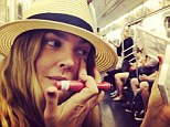 Subway styling! Drew Barrymore shares a selfie of herself applying make-up while riding the train