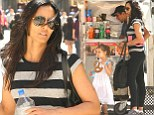 Make-up free Padma Lakshmi wears tight fitting exercise gear as she buys adorable daughter Krishna a pretzel