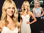 Actress Nicola Peltz, 19, joined co-star Mark Wahlberg for a photo call for Transformers: Age of Extinction dressed in a simple white dress that showed off her svelte frame with a classic girl-next-door vibe