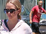 PICTURED: Kendra Wilkinson reunites with husband Hank Baskett after he 'leaves their Los Angeles home and checks into a hotel¿