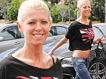 Tara Reid shows off her tanned tummy in a cropped shirt and jeans while going for a manicure in LA Sunday