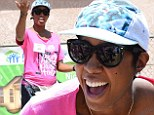 Kelly Rowland does not let her baby bump get in the way as she leads a team of stars building homes with Habitat For Humanity