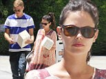 Cute duckie wrapping paper! Pregnant Rachel Bilson and fiancé Hayden Christensen carry presents to LA party
