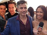 Transforming from dry to soggy! James Tobin and Rocsi Diaz get drenched on the red carpet
