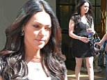 Laura Prepon wears a sexy black lace dress on a sunny New York day