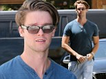 Fit like his father! Patrick Schwarzenegger looks comfortable in a tight-fitting shirt and joggers as he picks up an organic juice
