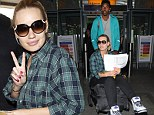 She's a low rider! Rapper Iggy Azalea arrives at London Heathrow on an luggage trolley pushed by her LA Lakers star boyfriend Nick Young