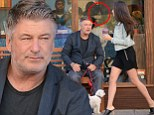 Eyes front! Alec Baldwin gets distracted by leggy brunette as he rests on bench while wife Hilaria buys him a smoothie