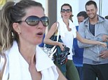 Fitness buddies! Gisele Bundchen breaks out a sweat in clingy workout gear at cycling class with husband Tom Brady