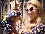 Flower power! Paris Hilton shares a snap of herself and beloved chihuahua Peter Pan donning matching daisy-patterned outfits
