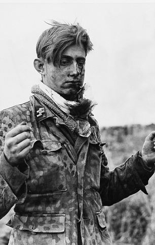 Hard fought: A wounded eighteen-year-old German sniper taken prisoner in the Caen-Tilly sector.