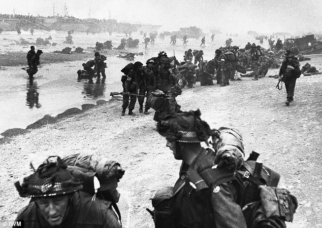 Easier than had been expected: After the initial landings on Sword Beach, round the port of Ouistreham, British troops prepare to move off the beach and push inland towards Caen - but then they ran into trouble