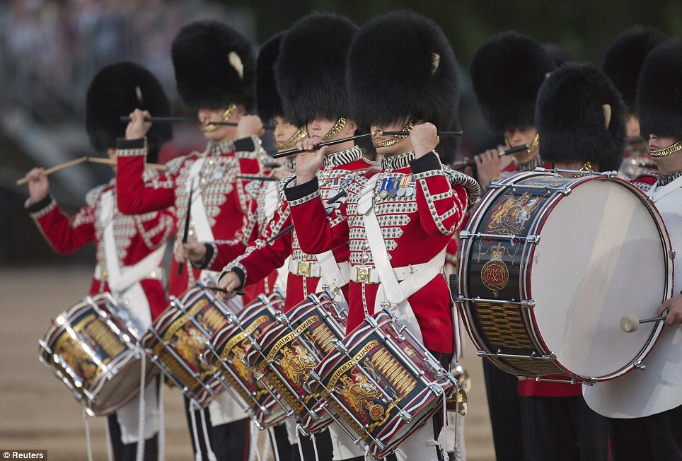 The Massed Bands of the Household Division perform at Beating Retreat which marked the 70th anniversary of D-Day landings and 100 years since the start of WWI