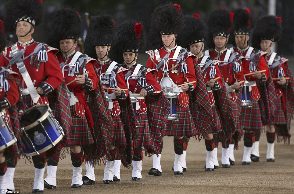 Pomp: Members of the Vancouver Police Pipe Band perform at the Beating Retreat military pageant at Horse Guards Parade last night