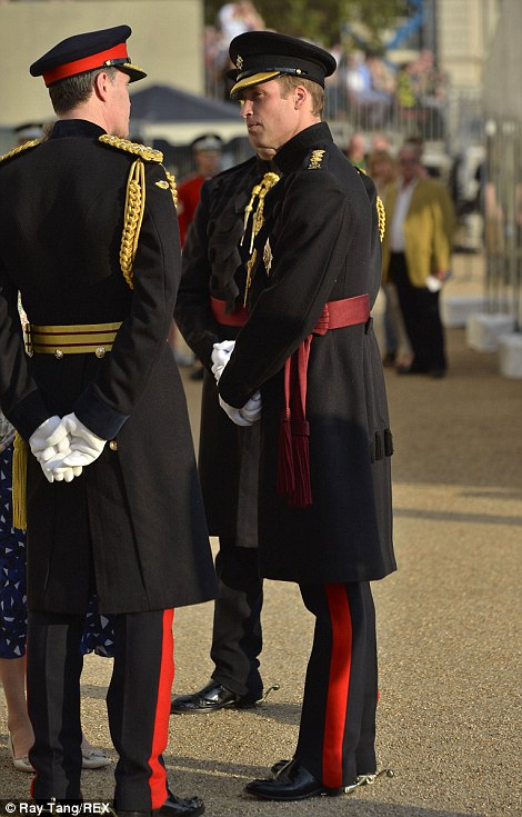 Prince William chats to another member of the Irish Guards
