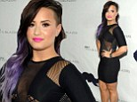 That's a tight squeeze! Demi Lovato shows off her slimmed down figure in clinging dress as she makes a stand for gay rights
