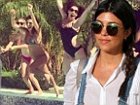 She is three months pregnant with her third child, so taking it easy should be top of her agenda.  But Kourtney Kardashian was clearly feeling energetic on Sunday and engaged in a sport of water fun.