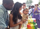 Kim Kardashian shares photo holding baby North with Kanye West at their daughter's extravagant first birthday party