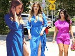 She's red hot in blue! Khloe Kardashian displays her long legs in a sexy thigh-high split dress while out with pregnant sister Kourtney