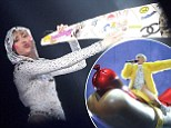 Miley Cyrus performs in a series of wacky outfits at the Ziggo DomE