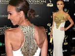 Giuliana Rancic stands out on the red carpet displaying her VERY thin frame... as she wins Fan Favourite at Daytime Emmys