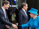 All smiles: The Queen beams as she is met by Heathrow's John Holland-Kaye and Colin Matthews as she arrives