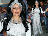 Lady Gaga flashes her underwear in semi sheer sparkling silver princess dress with matching headband in New York