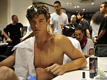 It's beautiful! A model does his best to look smoulderingly sexy - despite having his hair in curling rags