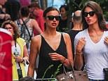 Relaxed: Despite her boyfriend, Cristiano Ronaldo's crunch match against the United States on Sunday, Irina Shayk walks through SoHo with a friend