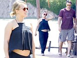 Pregnant Hayden Panettiere shows off bare baby bump for first time in loose-fitting black top as she steps out with fiancé Wladimir Klitschko