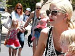 Tori Spelling was spotted taking three of her children to a friend's pool party in Encino, California on Sunday