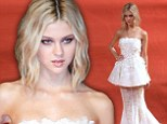Sugar and spice: Nicola Peltz teams elegant white lace gown with fierce eye make-up as she dazzles at Transformers Shanghai premiere