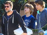 Pizza and footy for the boys! Super dad Russell Crowe grabs some take-away with his two mini-me sons Charles and Tennyson