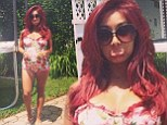 'My belt doesn't buckle!' Pregnant Snooki shows off her growing baby bump in floral one-piece swimsuit