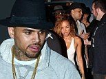 Back on the club scene! Chris Brown enjoys a night out on the town by partying with girlfriend Karrueche Tran