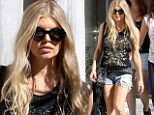 Incredible shrinking woman! Fergie, 39, shows off her svelte figure in daisy dukes and black vest alongside gal pals