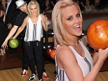 Bowl-a-rama! Jenny McCarthy and fiance Donnie Wahlberg roll the first ball at the World Record for Most People Bowling Simultaneously Across Multiple Venues Saturday in New York