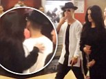 Pictured: Selena Gomez lovingly puts hand on Justin Bieber's back during movie date... just after sharing meal at romantic restaurant