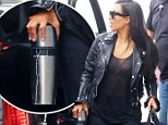 Hands-on mommy! Kim Kardashian has a 'lactating' Thermos as she arrives in NYC with little Nori