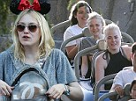 Dakota Fanning blends in with the crowd in Minnie Mouse ears during fun-filled outing to Disneyland... but gives her star status away with $3,400 Chanel backpack