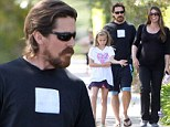 Family man: Christian Bale takes a casual stroll with pregnant wife Sibi Blazic and daughter Emmeline as they await baby's arrival
