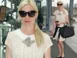 Shady lady: Kirsten hides behind huge sunnies on Tuesday as she sports cute flyaway dress, perfect for the airport!