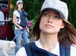 Mama's boys! Olivia Wilde goes make-up free for a leisurely stroll with her two-month-old son Otis and dog Paco